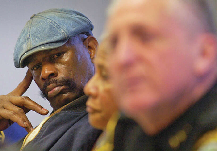 Amos Brown senior, father of Amos Brown Jr who was alain last year, lsitens to Norwalk Police Chief Harry Rilling speak at a press conference Thursday relating to the shooting incident that occurred Tuesday night at Norwalk Hospital. / (C)2011, The Hour Newspapers, all rights reserved