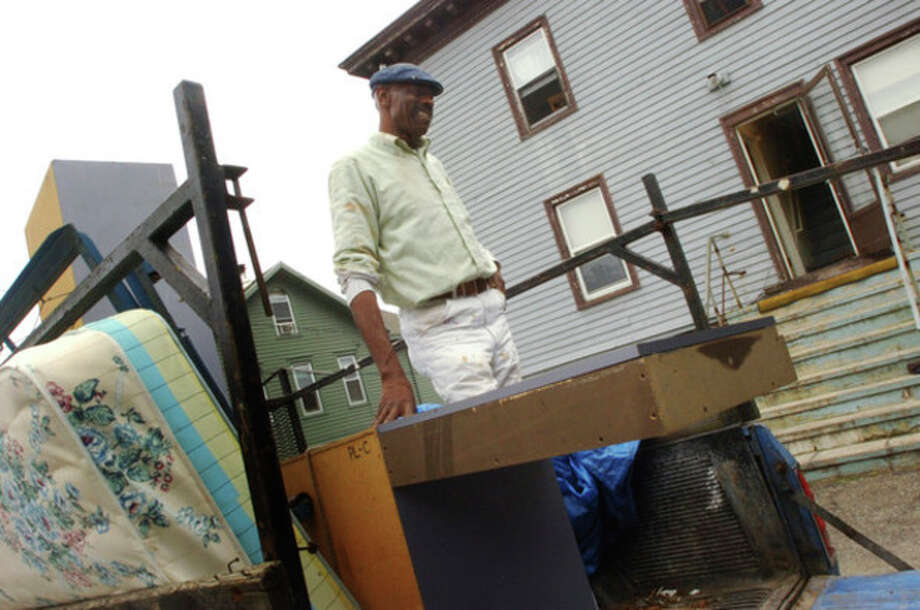 Amos Brown packs up his truck for the move to Georgia after his 7 Orchard St. home has been targeted by gunmen in the wake of his son's AJÕs arrest for the murder of 17-year-old Tykwan Hunt.