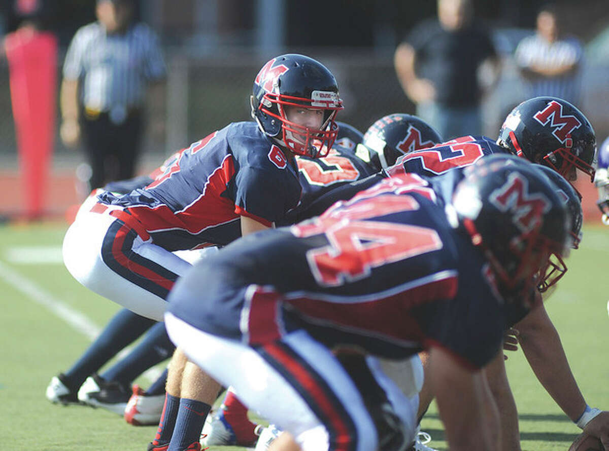 Hour photo/John Nash Brien McMahon football quarterback Matt Downey will call the shots during Thursday's game against Norwalk.