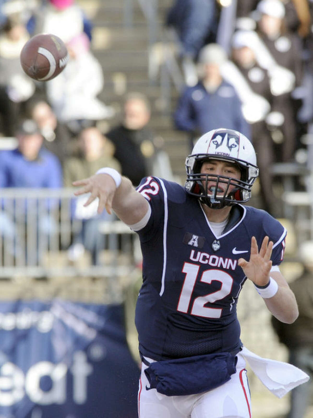 Connecticut quarterback Casey Cochran (12) passes during the first half of an NCAA college football game against Memphis, in East Hartford, Conn., on Saturday, Dec. 7, 2013. (AP Photo/Fred Beckham)