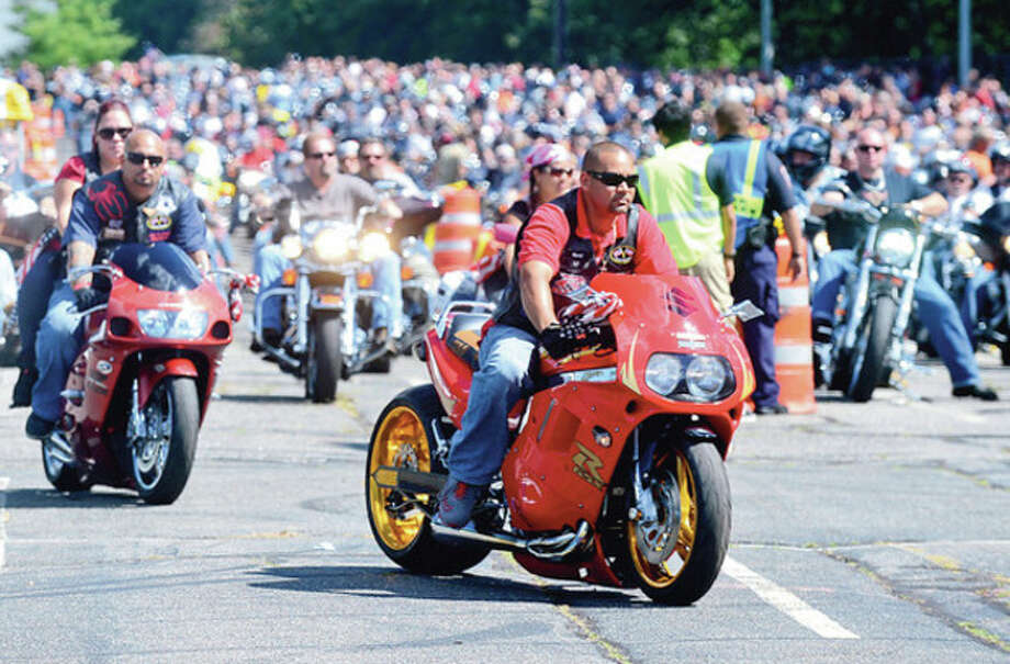 The CT United Ride tribute started out from Norden Park Saturday for the 12th annual motorcycle ride to benefit first responders and families affected by 9/11.Hour photo / Erik Trautmann / (C)2012, The Hour Newspapers, all rights reserved