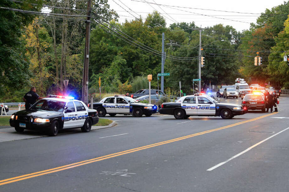 Stamford police block off Bridge Street outside of the Woodside Green condominiums thought to be the home of a woman killed by police in Washington, DC Thursday evening. Hour Photo / Chris Palermo