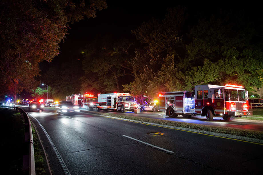Emergency response vehicles wait outside the apartment complex where Miriam Carey is believed to have lived in Stamford, Conn. Thursday, Oct. 3, 2013. Law-enforcement authorities have identified Carey, 34, as the woman who, with a 1-year-old child in her car, led Secret Service and police on a harrowing chase in Washington from the White House past the Capitol Thursday, attempting to penetrate the security barriers at both national landmarks before she was shot to death, police said. The child survived. (AP Photo/John Minchillo) / FR170537 AP