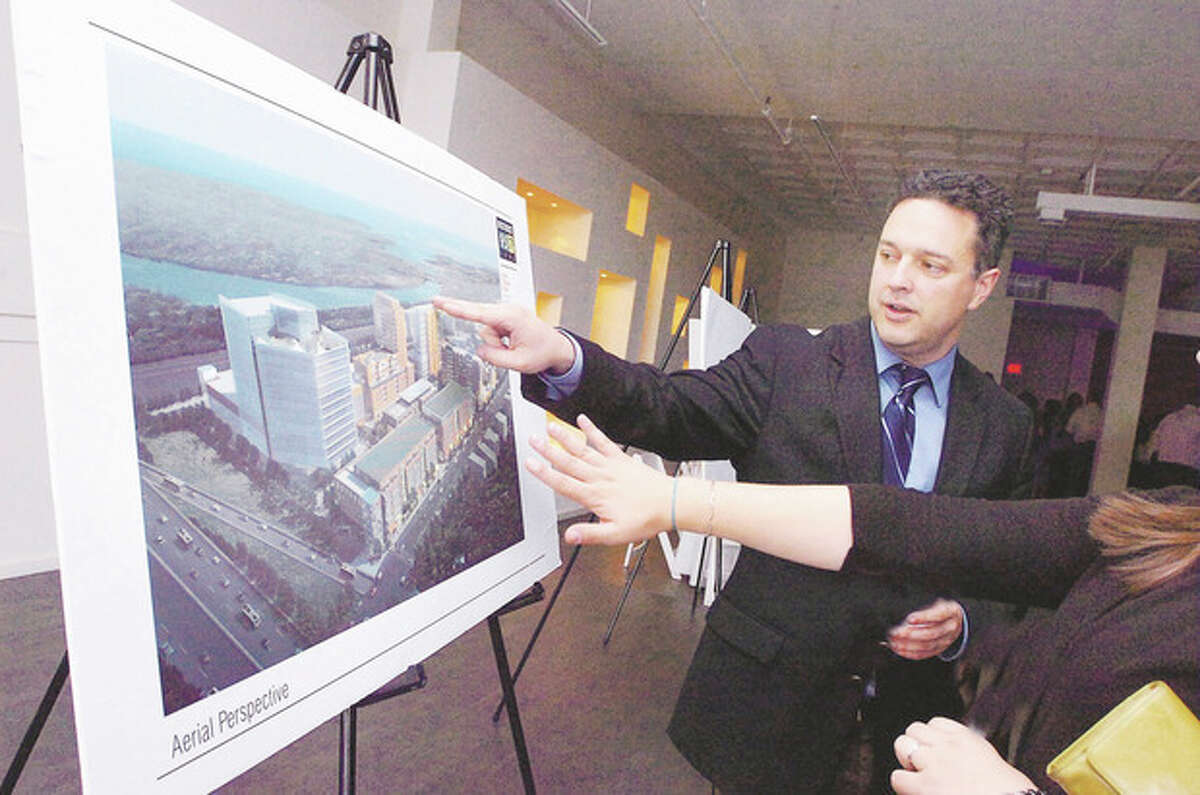 Munro Johnson Sr. Project Manager for Development shows an Aerial perspective of District 95/7 SoNo at the Norwalk Redevelopment Agency annual reception on Wednesday/hour photo matthew vinci