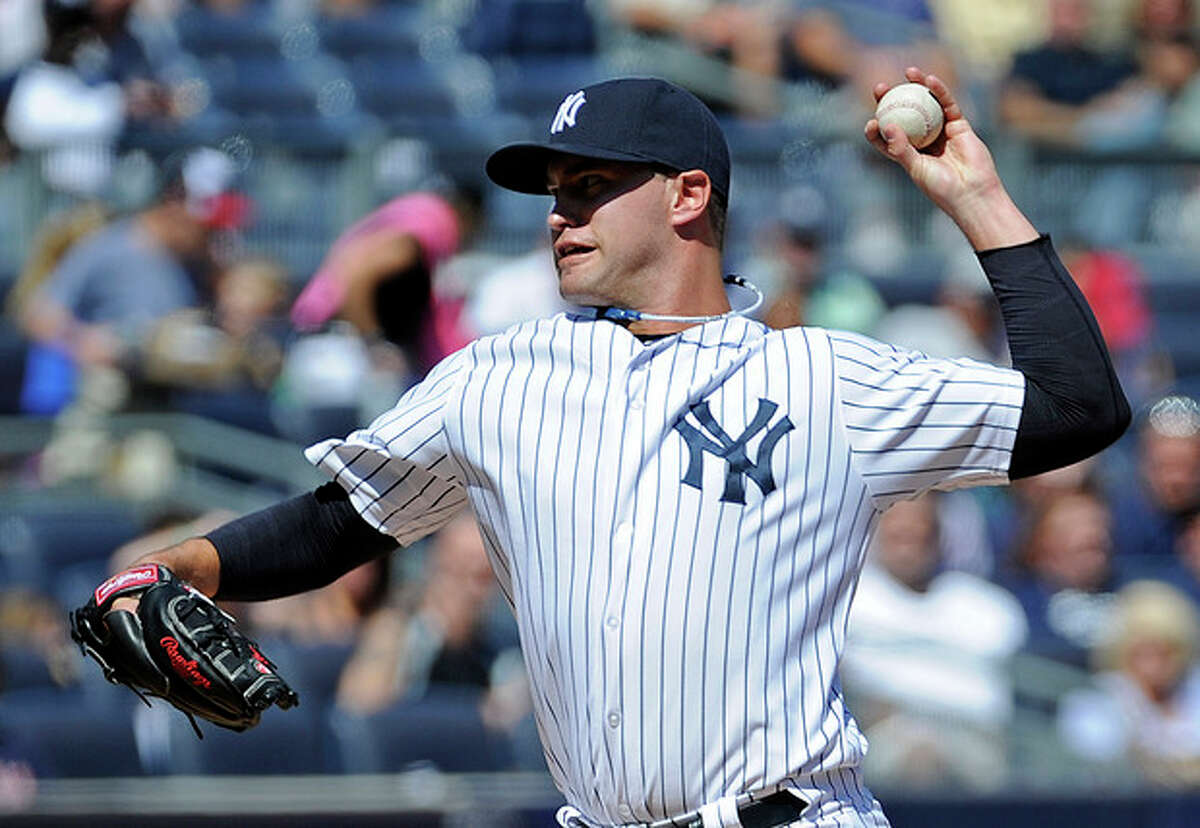 New York Yankees pitcher David Huff delivers the ball to the Boston Red Sox during the second inning of a baseball game Saturday, Sept. 7, 2013, at Yankee Stadium in New York. (AP Photo/Bill Kostroun)