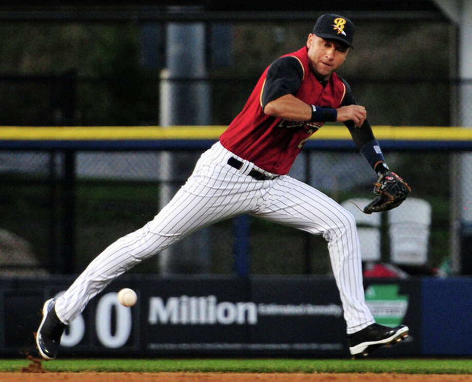 New York Yankees shortstop Derek Jeter goes for a ground ball during a rehab start with the Triple-A Scranton/Wilkes-Barre RailRiders, Friday, Aug. 23, 2013, in Moosic, Pa. (AP Photo/The Citizens' Voice, Andrew Krech) MANDATORY CREDIT / The Citizens' Voice