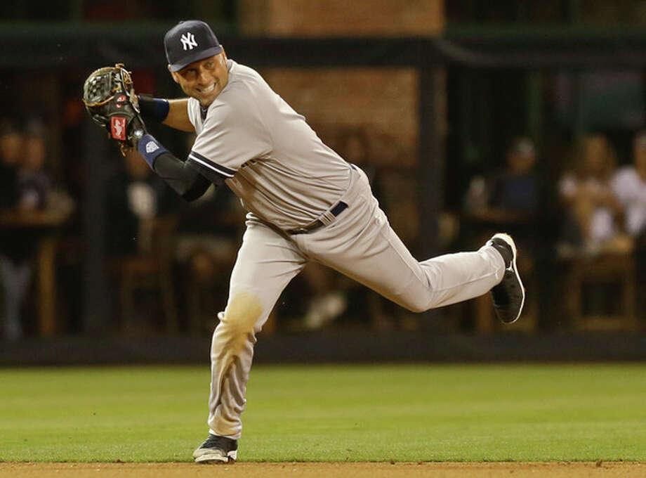 New York Yankees shortstop Derek Jeter tries to get a grip on the ball after fielding a hard grounder hit by San Diego Padres' Nick Hundley in the seventh inning of a baseball game in San Diego, Friday, Aug. 2, 2013. Jeter threw to second but the throw was wide. (AP Photo/Lenny Ignelzi) / AP