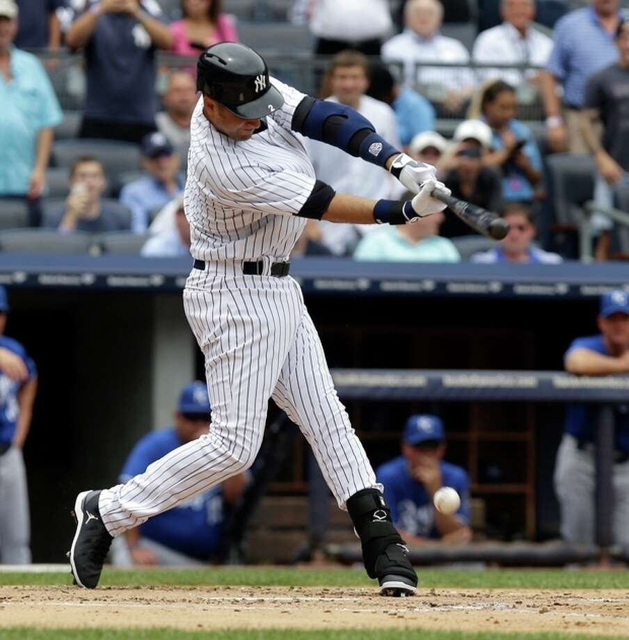 New York Yankees' Derek Jeter singles during the first inning of a baseball game against the Kansas City Royals at Yankee Stadium Thursday, July 11, 2013, in New York. (AP Photo/Seth Wenig) / AP