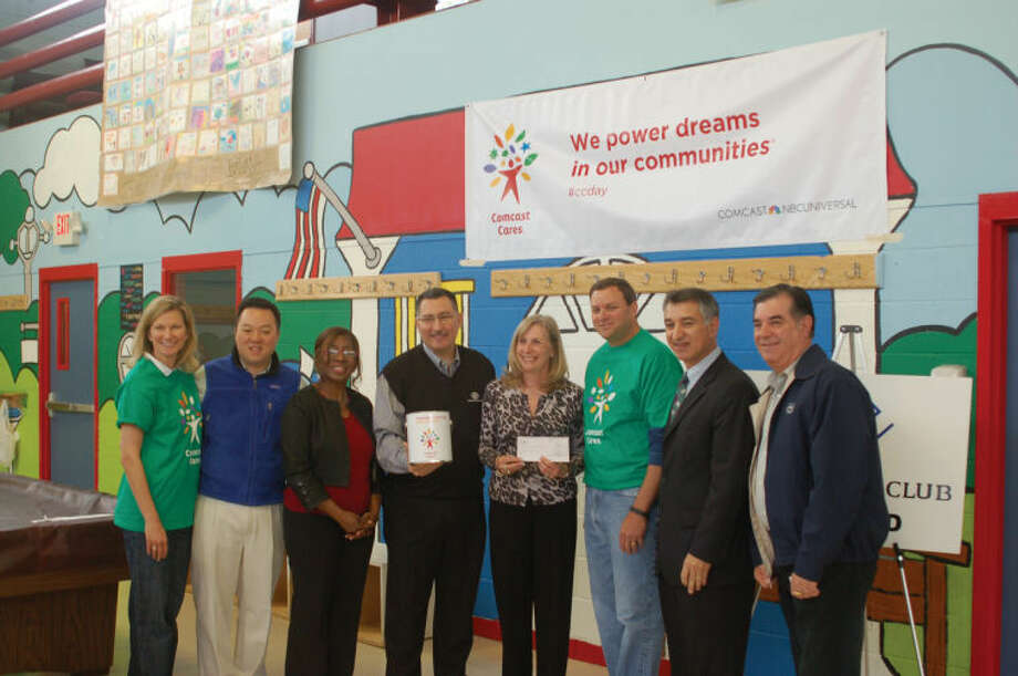 The Boys & Girls Club of Stamford was recently chosen as one of the eight sites across Connecticut for Comcast Cares Day. Pictured from left to right are: Kristen Roberts, vice president of public relations and community investment for Comcast Western New England Region; state Rep. William Tong; Stamford Boys & Girls Club board member Jenice Jeter; Stamford Boys & Girls Club Executive Director Michael Cotela; Stamford Boys & Girls Club board member Karyn Ward; Mark Lazarus, chairman of NBC Sports Group; state Sen. Carlo Leone; and Mayor Michael Pavia.
