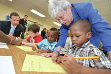 Hour Photo/Alex von Kleydorff . Lt. Governor Nancy Wyman visits the Norwalk Brighter Futures program at Marvin Elementary school and helps Clarence Joseph with a handwriting exercise.