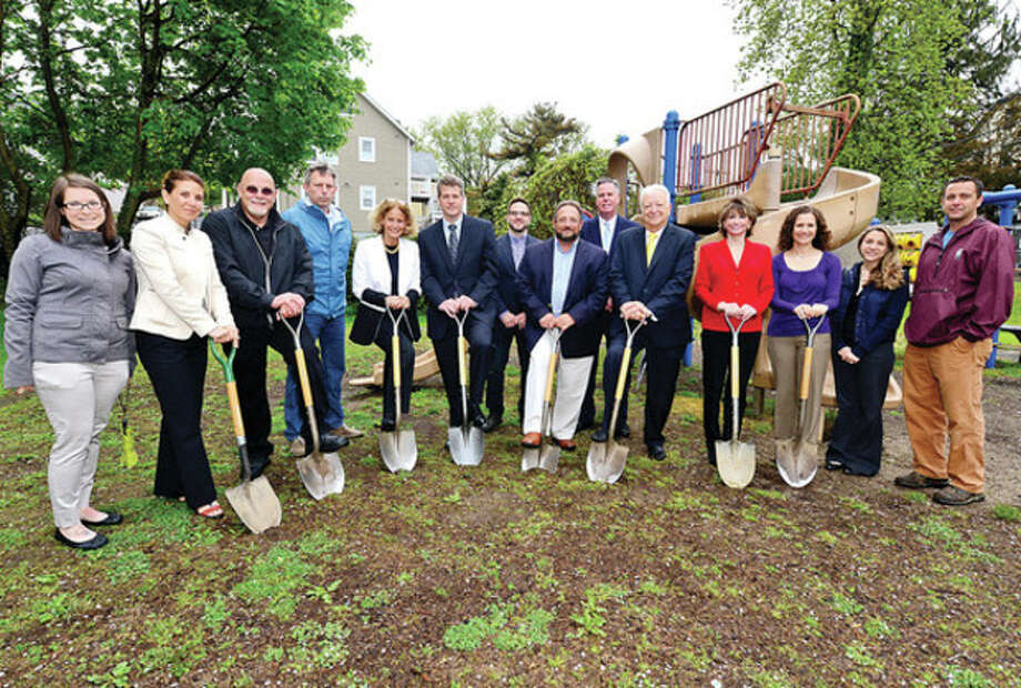 Courtney Hartl, Northeast Community Church, Roni Goldberg, Tauk Inc, Jerry Petrini Recreation and Parks, Anthony Allison, Norwalk Children's Foundation, Amy Nenner, Beiersdorf, Bill Graham, Beiersdorf president, Thomas Mahoney, Northeast Community Church pastor, Michael Moccia, Norwalk Recreation and Parks director, Ed Musante, Greater Norwalk Chamber of Commerce, Ruth Ann Walsh, Pepperidge Farm, Kathleen Fischer, Factset Research Systems, Norma Cappauccia, Factset Research Systems and Ken Hughes, Norwalk Recreation and Parks, and listen to Norwalk Mayor Richard Moccia thank them during the groundbreaking ceremony for a new state-of -the art playground at Bouton Park in South Norwalk Thursday. The new playground will be built at the Bouton Street Park thanks to the partnership of the Norwalk Corporate Citizenship Alliance (NCCA), a committee of the Greater Norwalk Chamber of Commerce, and the Department of Recreation and Parks.Hour photo / Erik Trautmann / (C)2013, The Hour Newspapers, all rights reserved