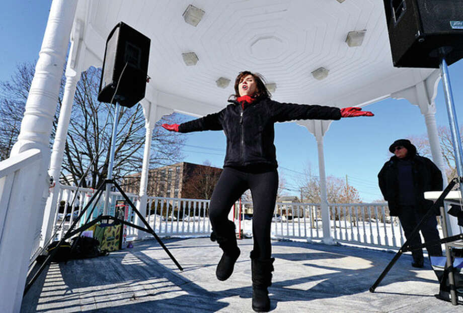 Zumba instructor Michele Ayoub joins supporters of the Domestic Violence Crisis Center as they come together to rally, dance and ring bells in support of the One Billion Rising Global Campaign against domestic violence Thursday at The Norwalk Green.Hour photo / Erik Trautmann / (C)2012, The Hour Newspapers, all rights reserved