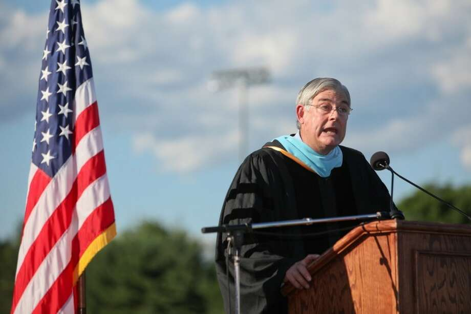 Superintendent of Schools Gary G. Richards addresses the Wilton High School class of 2012 during the commencement ceremonies Saturday evening. Hour Photo / Chris Palermo