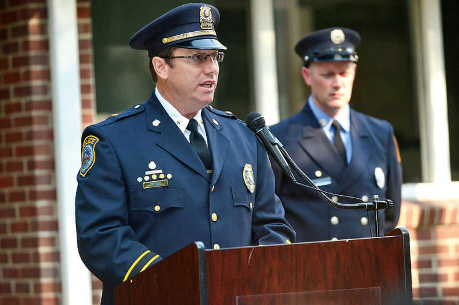 Wilton Police Department Deputy Chief Robert Crosby makes his remarks during the Wilton 9/11 memorial ceremonies Wednesday at the Wilton Fire Department. Hour photo / Erik Trautmann