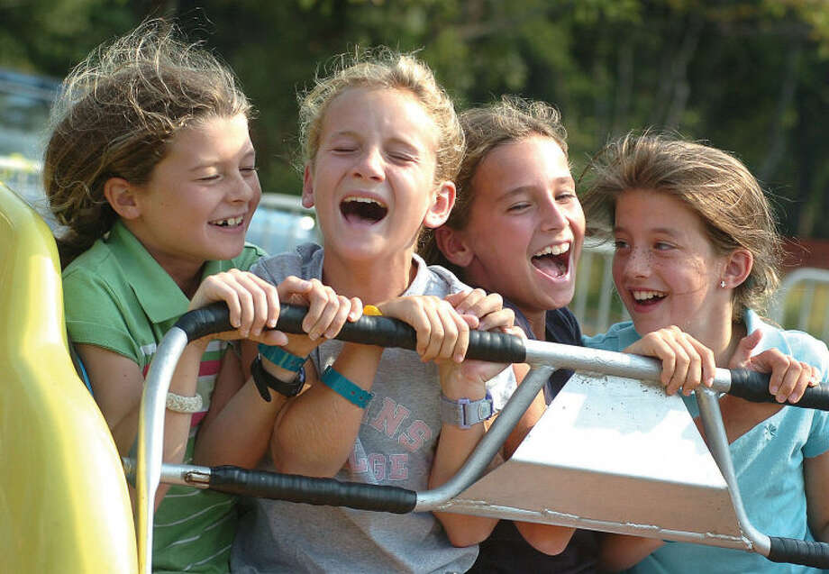L-R Cait Callahan , Christy Smith, Brooke Connolly and Kailey Zengo all 5th grade 10 yr olds ride the scrambler at the Rotary carnival on Saturday photo;alex von kleydorff file-09-15-06