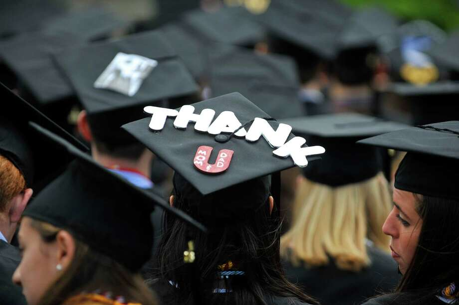 Click through for a gallery of 2016 college graduation ceremonies. Graduates watch as diplomas are distributed at the Union College commencement exercises on Sunday, June 12, 2016, in Schenectady, N.Y.  Degrees were handed out to approximately 550 students on Sunday during the college's 222 graduation.  (Paul Buckowski / Times Union) Photo: PAUL BUCKOWSKI / 10036377A