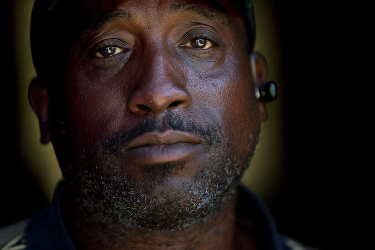 In this Sept. 19, 2012 picture, homeless veteran Jerome Belton poses for a portrait at a homeless shelter in San Diego. A former Marine, Belton now lives on the streets in San Diego. Despite budget increases and an aggressive strategy, the Obama administration struggles to make good on its audacious promise: End homelessness among veterans by 2015. (AP Photo/Gregory Bull)
