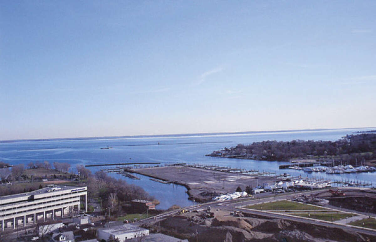 Hour photos / Erik Trautmann Gov. Dannel Malloy says Bridgewater Associates is moving from Westport to Building and Land Management's Harbor Point development, seen above, in Stamford.