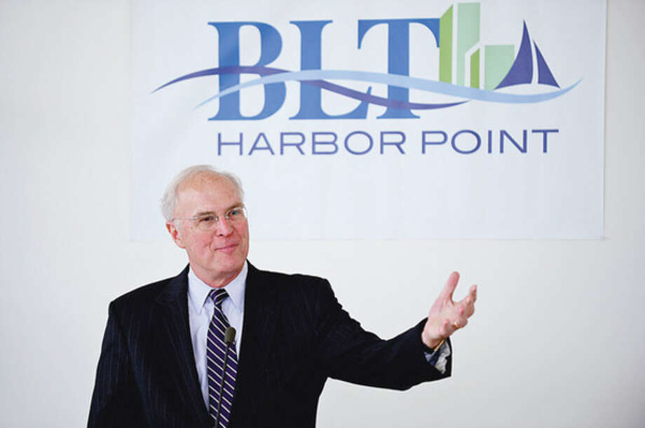 President & CEO of the Business Council of Fairfield County, Chris Bruhl, introduces Governor Dannel Malloy during a press event announcing the move of BrigewaterAssociates to Building and Land Management's Harbor Point development in Stamford Wednesday.Hour photo / Erik Trautmann / (C)2012, The Hour Newspapers, all rights reserved