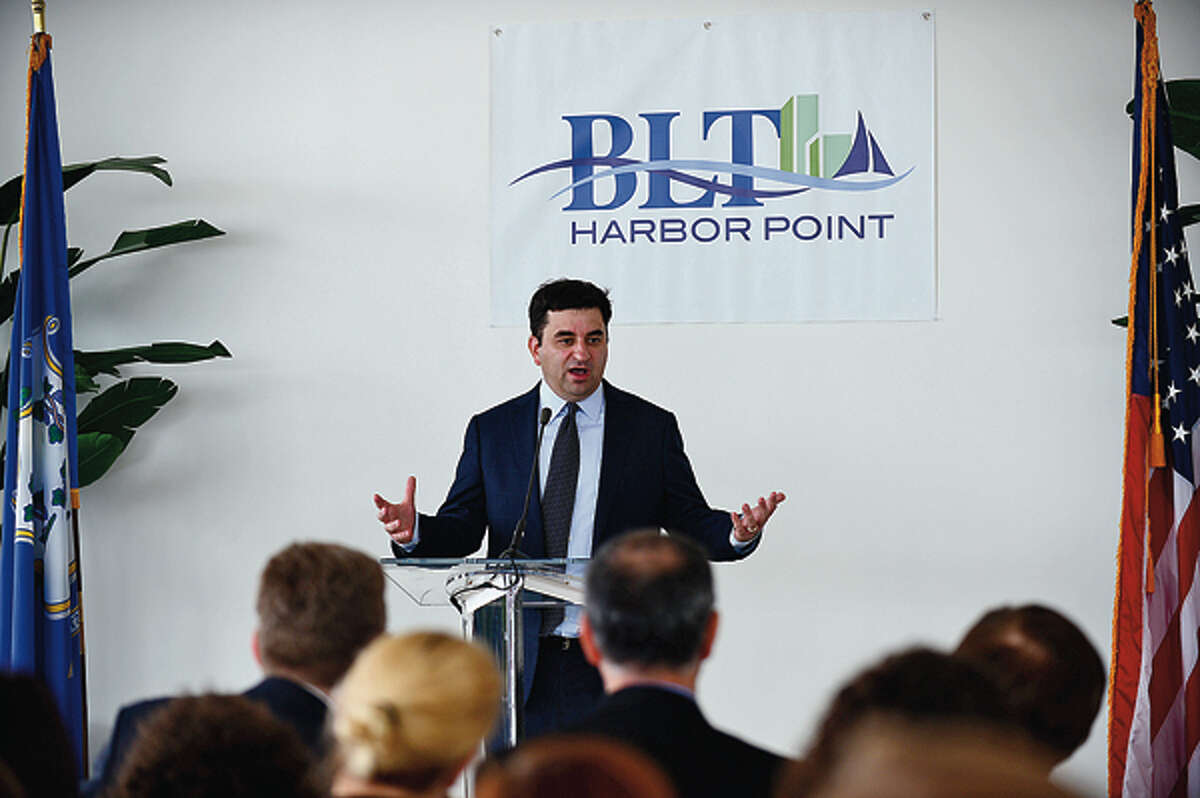Co-CEO of Bridgewater Associates, Greg Jensen, speaks during a press event announcing the move of Brigewater Associates to Building and Land Management's Harbor Point development in Stamford Wednesday. Hour photo / Erik Trautmann