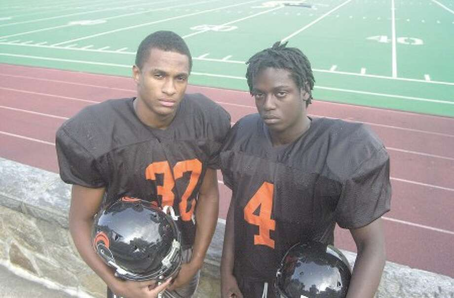 Photo by John Nash - Stamford linebackers Khairi Fortt, left, and Patrick Atkinson.