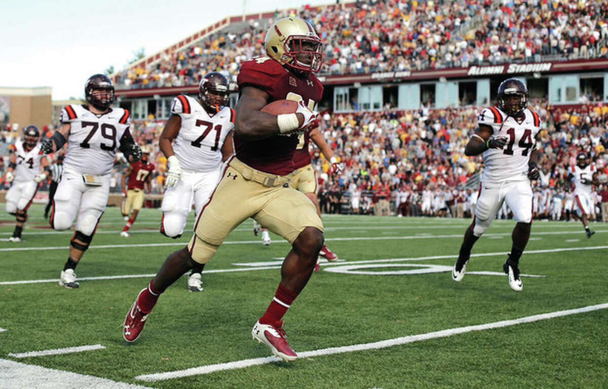 AP photo Boston College linebacker Kevin Pierre-Louis, a resident of Norwalk, runs an interception back for a touchdown past Virginia Tech defenders during Saturday's game in Chestnut Hill, Mass.