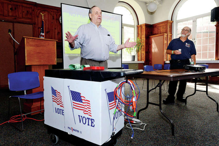 Hour photo / Erik TrautmannIn this file photo, Democratic Registrar of Voters Stuart Wells and Robert Sodaro hold poll worker training at City Hall Thursday for next Tuesday's Democratic mayoral primary election. / (C)2013, The Hour Newspapers, all rights reserved