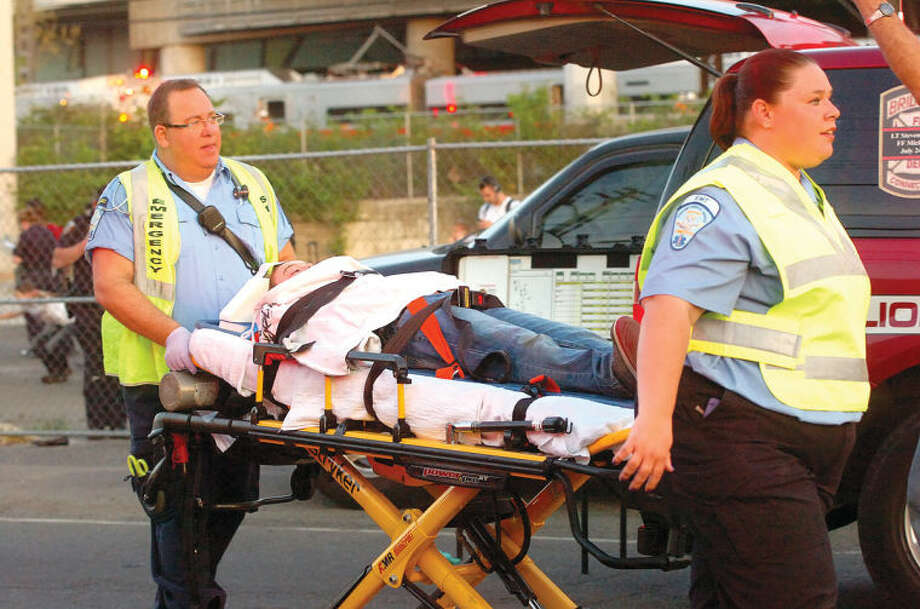 Hour Photo/Alex von Kleydorff. A girl is moved to an ambulance on a stretcher after two Metro North trains collided in Bridgeport Friday night.