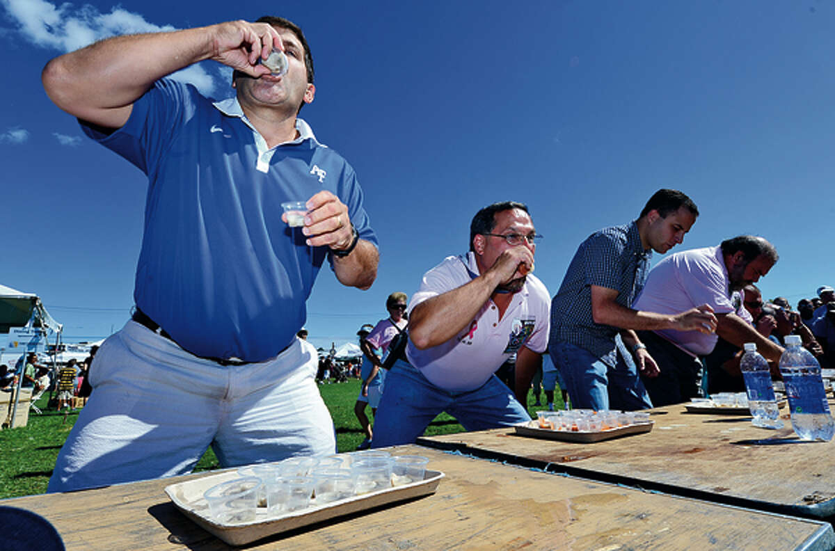 Brien McMahon High School Athletic Director Joe Madaffari competes in the Oyster Slurping Contest at the 35th annual Oyster Festival at Veteran's Memorial Park Sunday. Hour photo / Erik Trautmann