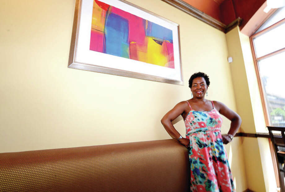 Hour photo / Erik TrautmannValerie Cooper, curator of upcoming ARTWALK in Stamford, with some of the artwork to be exhibited on next weekend's ARTWALK. / (C)2013, The Hour Newspapers, all rights reserved