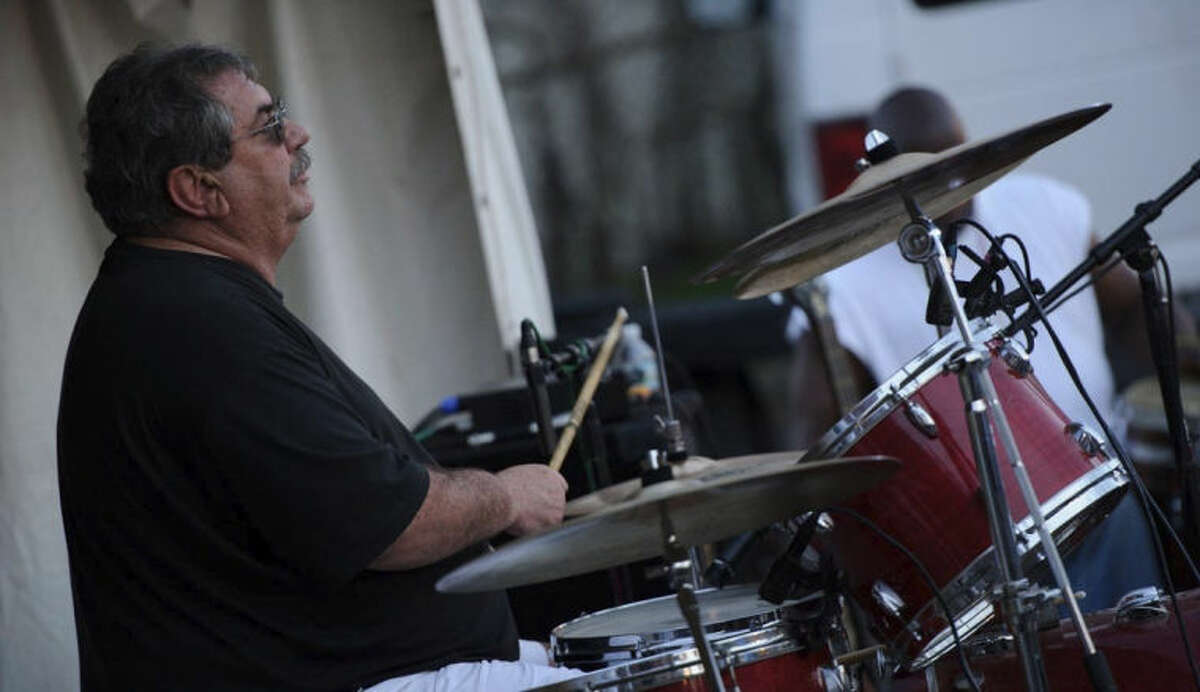 Contributed photo Tim Currie playing the drums with his MoTown band.