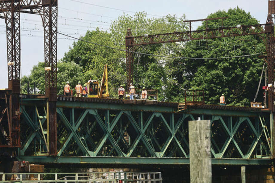 Hour photo / Erik Trautmann Metro-North Railroad and CT DOT give local media a tour of the inner workings of the 118-year-old Walk train bridge in Norwalk Wednesday.