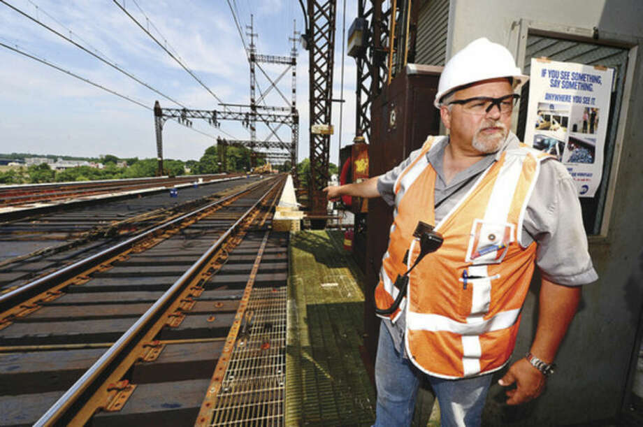 Hour photo / Erik Trautmann Metro-North Railroad and CT DOT officials, including Metro-North Structures Supervisor Anthony Caruso, give local media a tour of the inner workings of the 118-year-old Walk train bridge in Norwalk Wednesday.
