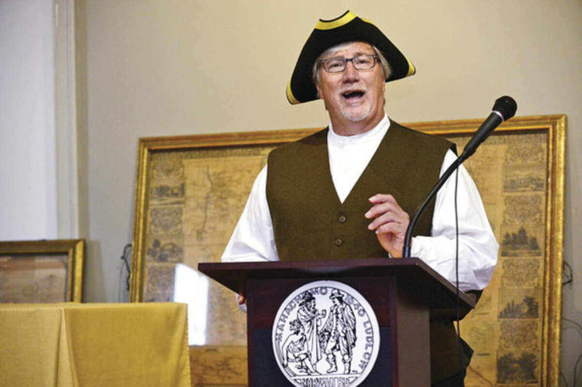 """Hour photo / Erik Trautmann In this file photo from 2014, Rick McQuaid, City of Norwalk Town Clerk reads the Declaration of Independance while portraying Revolutionary War Town Clerk Samuel Grumman during The Norwalk Historical Society """"Let Freedom Ring, National Bell Ringing Ceremony"""" at Mill Hill Historic Park."""
