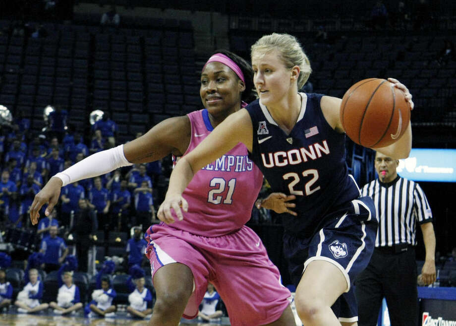Connecticut's Tierney Lawlor (22) drives past Memphis' Asianna Fuqua-Bey (21) in the second half of an NCAA college basketball game Saturday, Feb. 7, 2015, in Memphis, Tenn. (AP Photo/Karen Pulfer Focht)