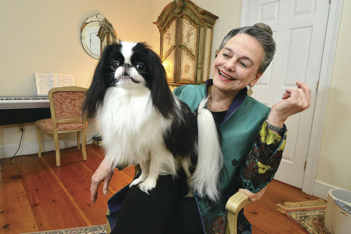Hour Photo/Alex von Kleydorff Dr. Anita M Lopker poses with her Japanese Chin, Valentino, they will compete in Best of Breed at the Westminster Dog Show.