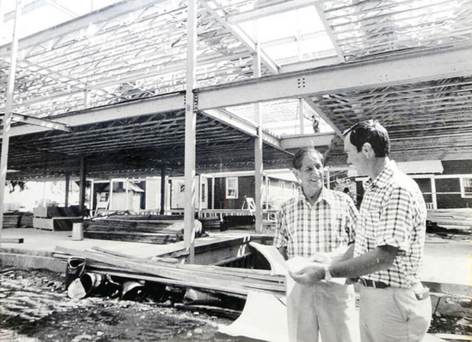 Hour photo / Erik Trautmann Hour photo / Erik Trautmann Owner of Joseph A. Marino Contractors, Lew Marino, right, with his father, the late Joseph A. Marino, at the company's first development, Joseph A. Marino Square, on Main Ave. The company is celebrating their 75th anniversary this year.
