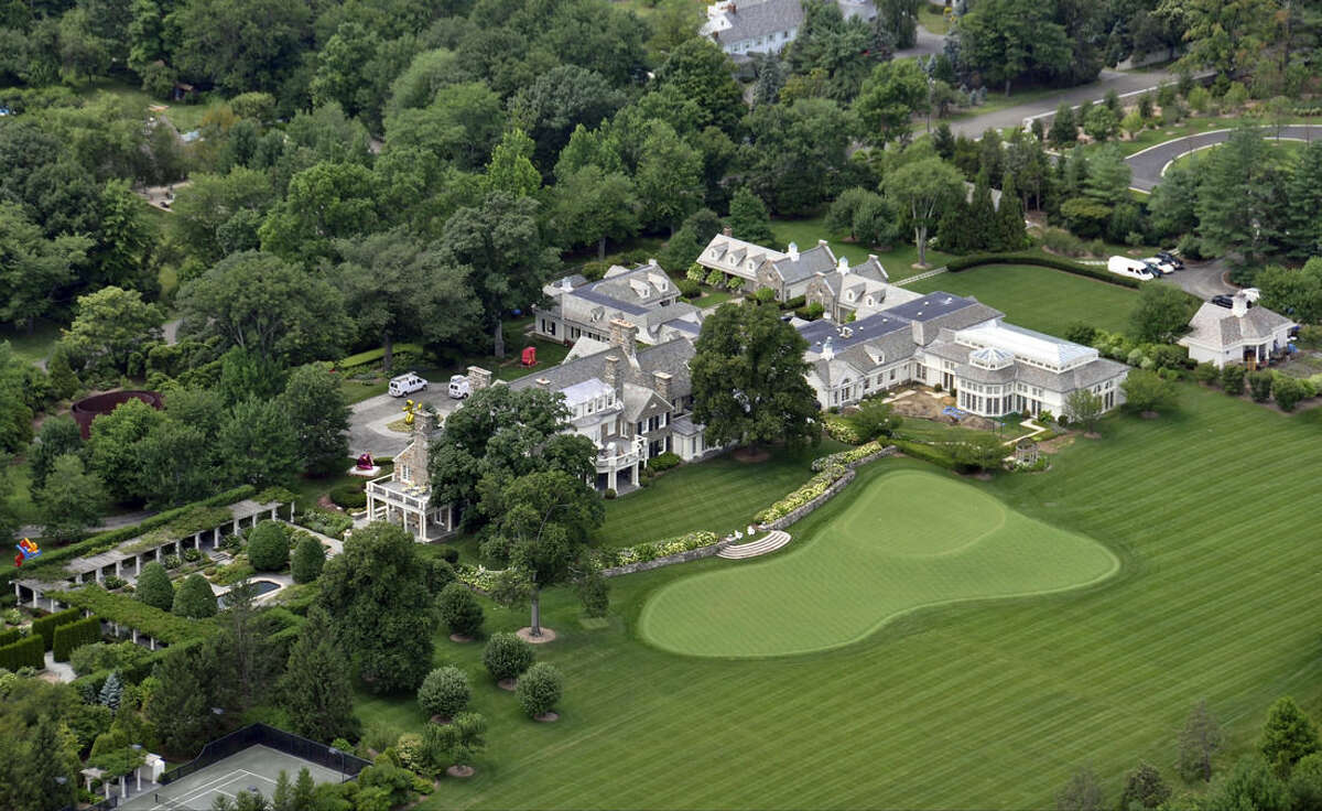 FILE - This July 26, 2013 aerial file photo shows the Greenwich, Conn., estate belonging to billionaire hedge fund owner Stephen Cohen. In a Connecticut, home to some of the richest Americans including Cohen, tax officials go to some lengths to keep them -- and the billions of dollars in revenue their income taxes generate. (AP Photo/Vincent T. Vuoto, File)