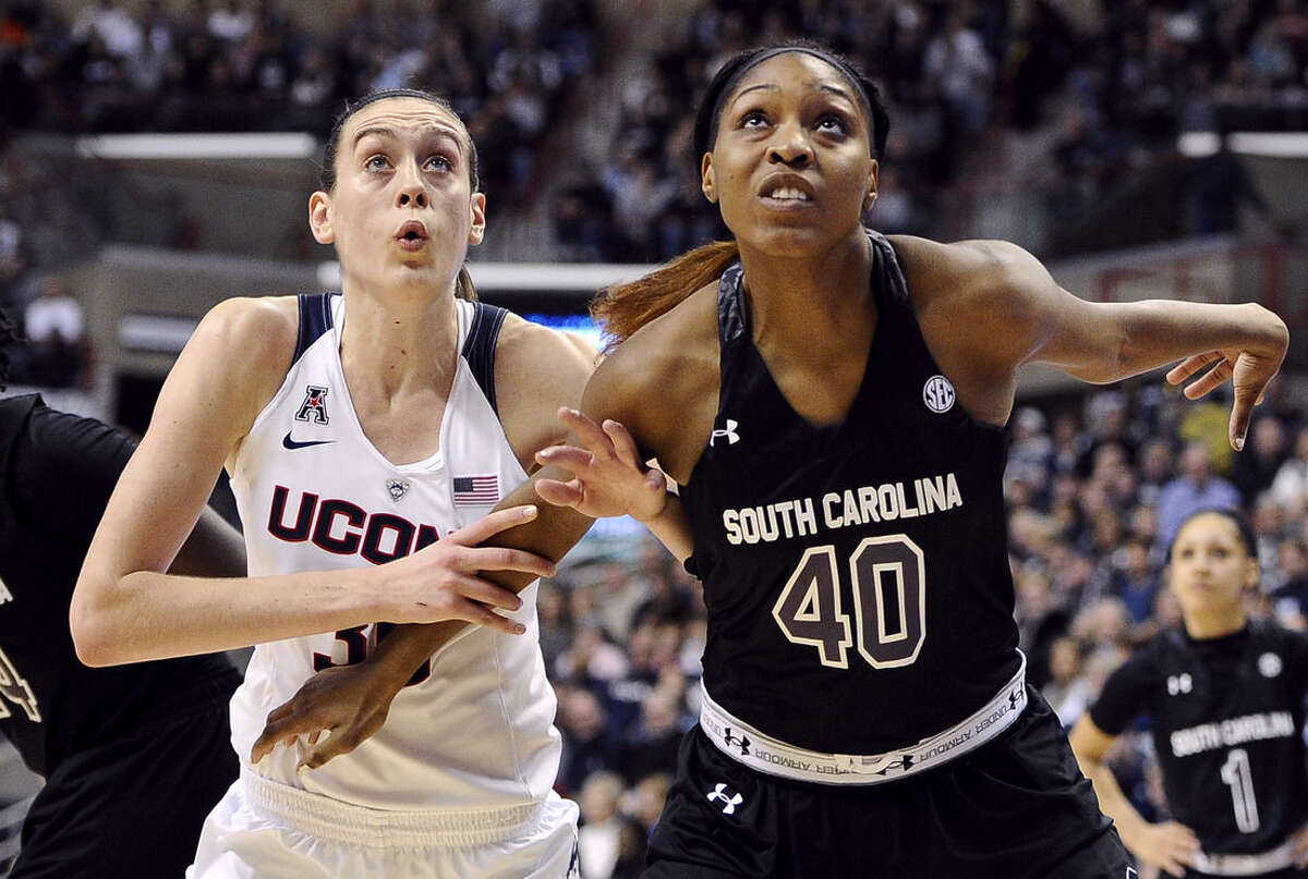 Connecticut's Breanna Stewart, left, and South Carolina's Jatarie White, right, look for a rebound during the first half of an NCAA college basketball game, Monday, Feb. 9, 2015, in Storrs, Conn. (AP Photo/Jessica Hill)
