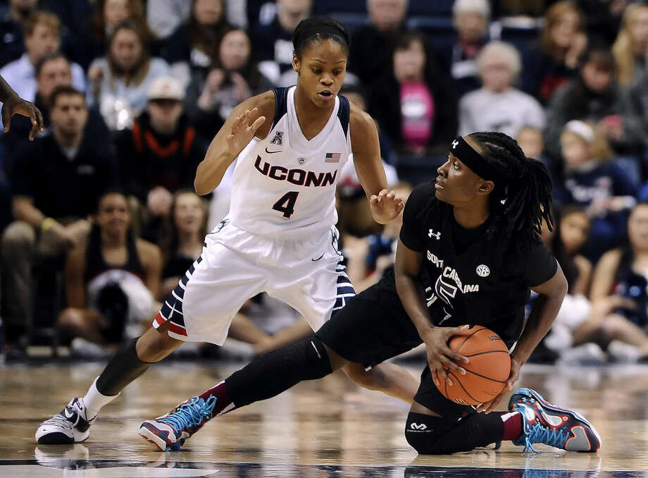 South Carolina's Khadijah Sessions looks to pass as Connecticut's Moriah Jefferson, left, defends during the first half of an NCAA college basketball game, Monday, Feb. 9, 2015, in Storrs, Conn. (AP Photo/Jessica Hill)