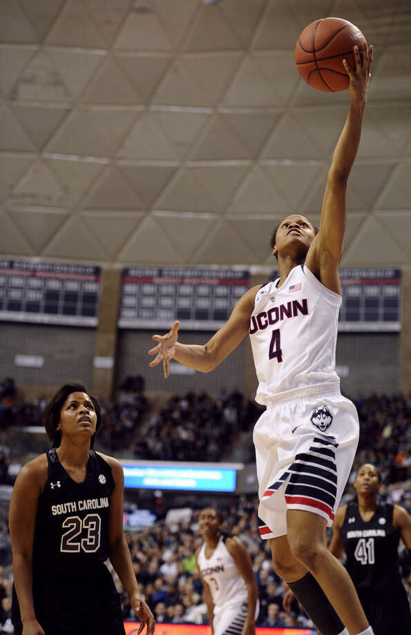 South Carolina's Tina Roy, left, watches as Connecticut's Moriah Jefferson scores on a break away during the first half of an NCAA college basketball game, Monday, Feb. 9, 2015, in Storrs, Conn. (AP Photo/Jessica Hill)