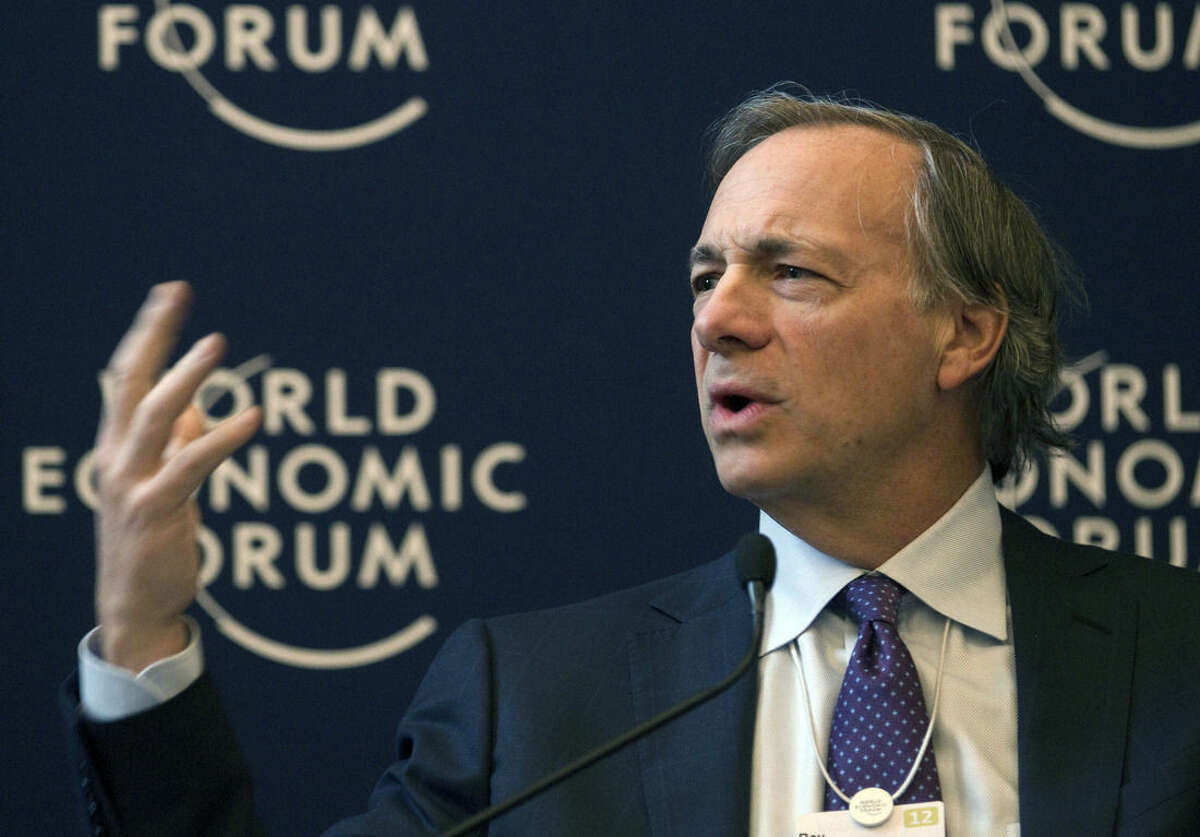 FILE - In this Jan. 25, 2012 file photo, Ray Dalio, founder and co-chief investment officer of Bridgewater Associates, speaks during a panel session on the first day of the 42nd annual meeting of the World Economic Forum, WEF, in Davos, Switzerland. In a Connecticut, home to some of the richest Americans including Dalio, tax officials go to some lengths to keep them -- and the billions of dollars in revenue their income taxes generate. (AP Photo/Anja Niedringhaus, File)