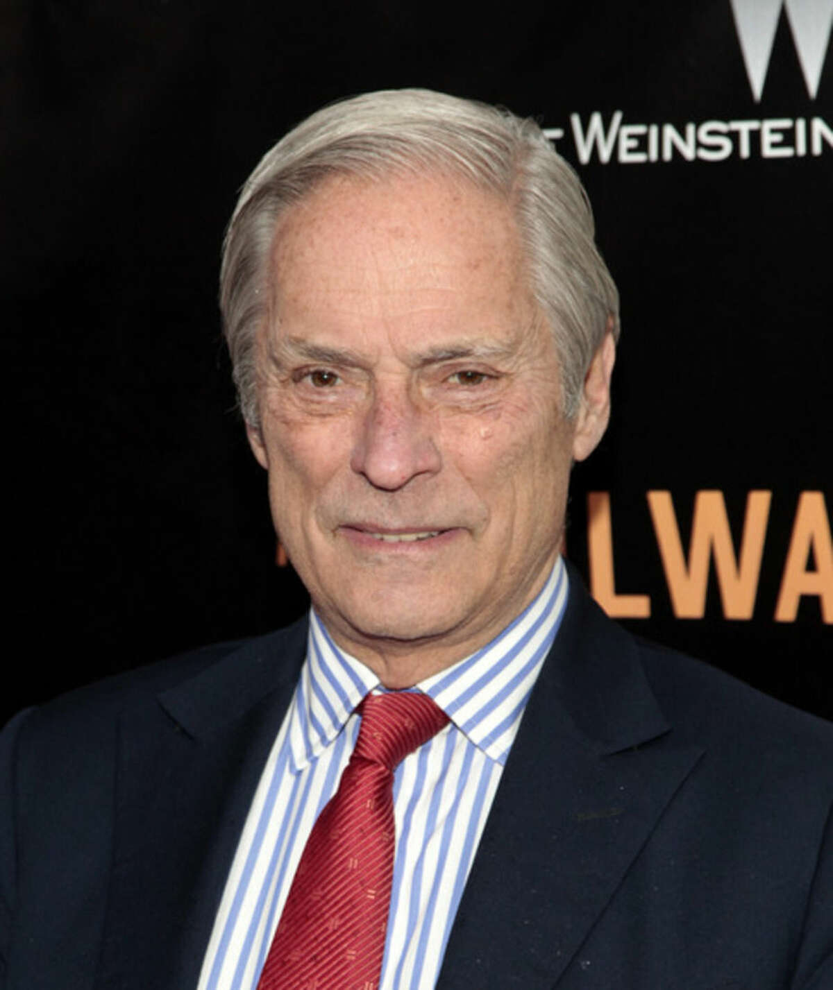 """FILE - In this April 7, 2014 file photo, Bob Simon of """"60 Minutes,"""" attends the New York premiere of """"The Railway Man"""" in New York. CBS says Simon was killed in a car crash on Wednesday, Feb. 11, 2015, in Manhattan. Police say a town car in which he was a passenger hit another car. He was 73. (Photo by Andy Kropa/Invision/AP, File)"""