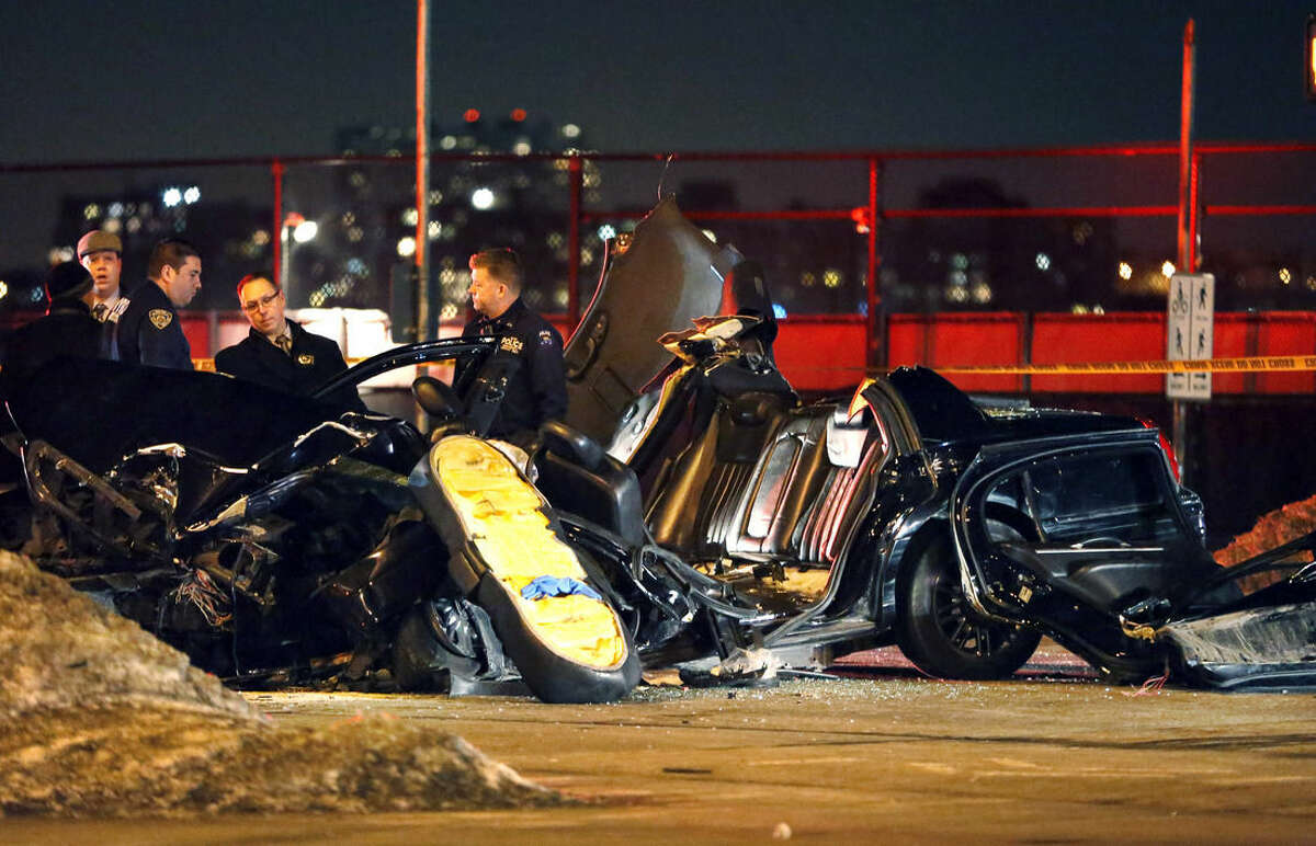 """Officials survey the scene of an accident following a collision in New York, Wednesday, Feb. 11, 2015, that killed longtime """"60 Minutes"""" correspondent Bob Simon. Simon, who was 73, covered riots, Academy Award-nominated movies and wars and was held captive for more than a month in Iraq two decades ago. (AP Photo/Kathy Willens)"""