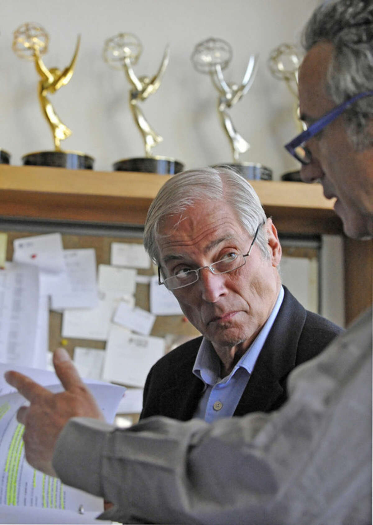 """In this March 24, 2010 photo released by CBS, """"60 Minutes"""" correspondent Bob Simon, speaks with a news producer at the CBS Broadcast Center in New York. CBS says Simon was killed in a car crash on Wednesday, Feb. 11, 2015, in Manhattan. Police say a town car in which he was a passenger hit another car. He was 73. (AP Photo/CBS, John Paul Filo)"""