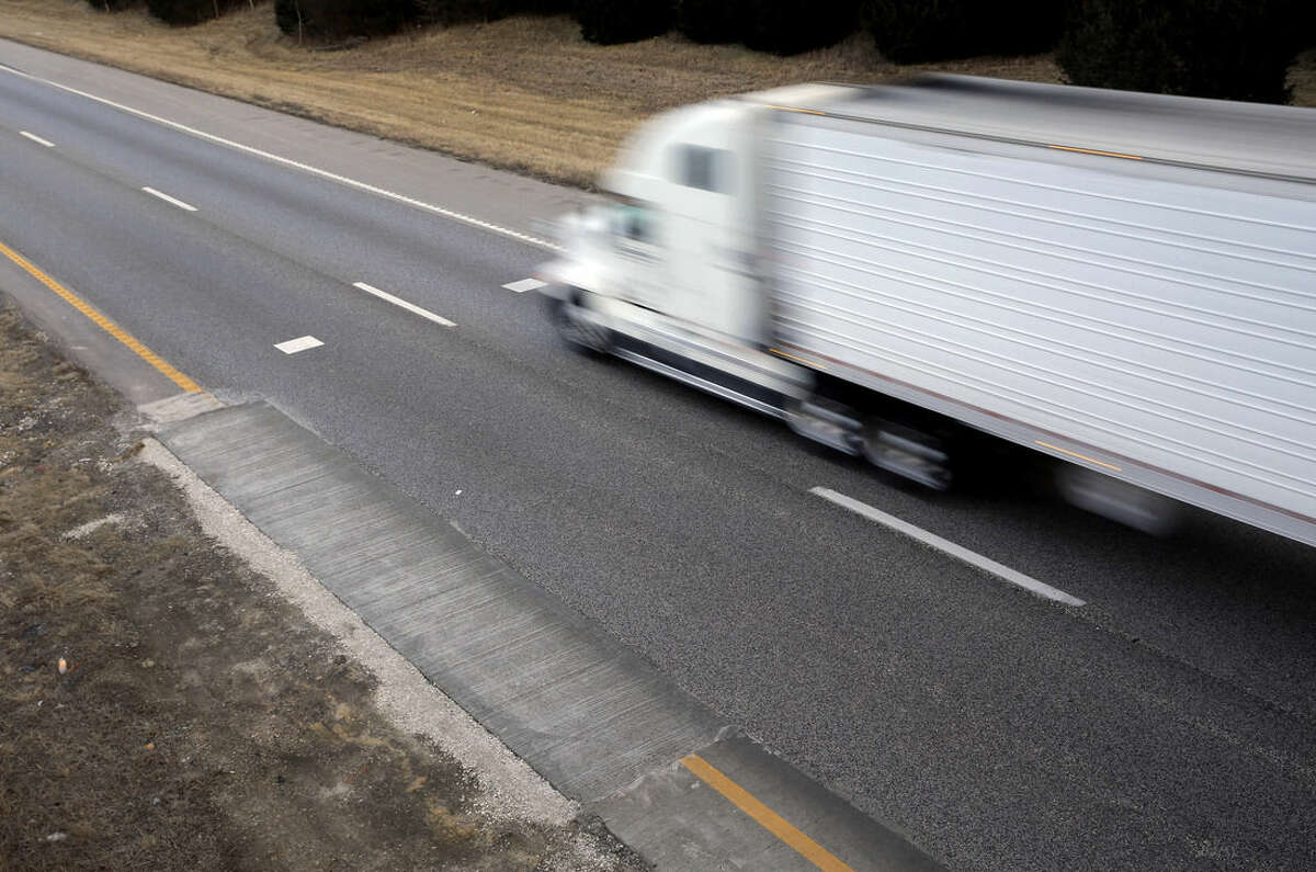 ADVANCE FOR SATURDAY, FEB. 21, 2015, AND THEREAFTER - In this Thursday, Feb. 12, 2015 photo, a tractor-trailer travels past a patched portion of Interstate 70 in Wright City, Mo. Built in the 1950s and 60s with an expected life of 20 years, a 200-mile span of the four-lane interstate between suburban St. Louis and Kansas City is crumbling beneath its surface as it carries more than 30,000 vehicles a day on many of its rural stretches. (AP Photo/Jeff Roberson)