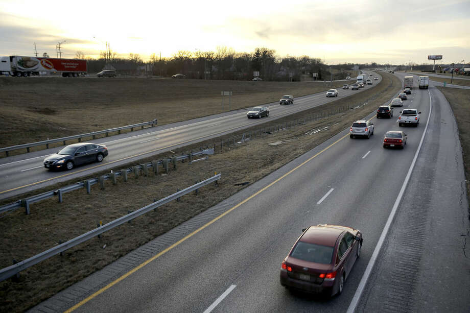 ADVANCE FOR SATURDAY, FEB. 21, 2015, AND THEREAFTER - In this Thursday, Feb. 12, 2015 photo, vehicles travel along Interstate 70 in Foristell, Mo. Built in the 1950s and 60s with a life expectancy of 20 years, a 200-mile span of the four-lane interstate between suburban St. Louis and Kansas City is crumbling beneath its surface as it carries more than 30,000 vehicles a day on many of its rural stretches. (AP Photo/Jeff Roberson)
