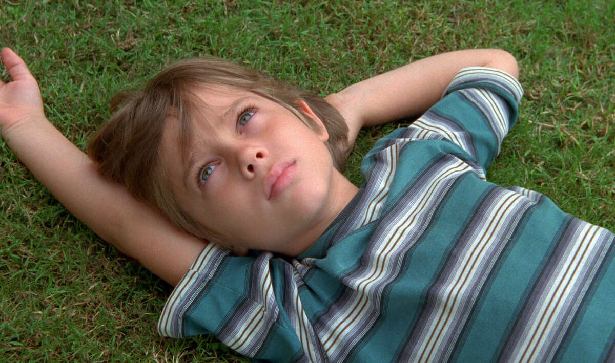 """This image released by IFC Films shows Ellar Coltrane at age six in a scene from the film,""""Boyhood."""" The film is nominated for an Oscar Award for best feature. The 87th Annual Academy Awards will take place on Sunday, Feb. 22, 2015 at the Dolby Theatre in Los Angeles. (AP Photo/IFC Films)"""