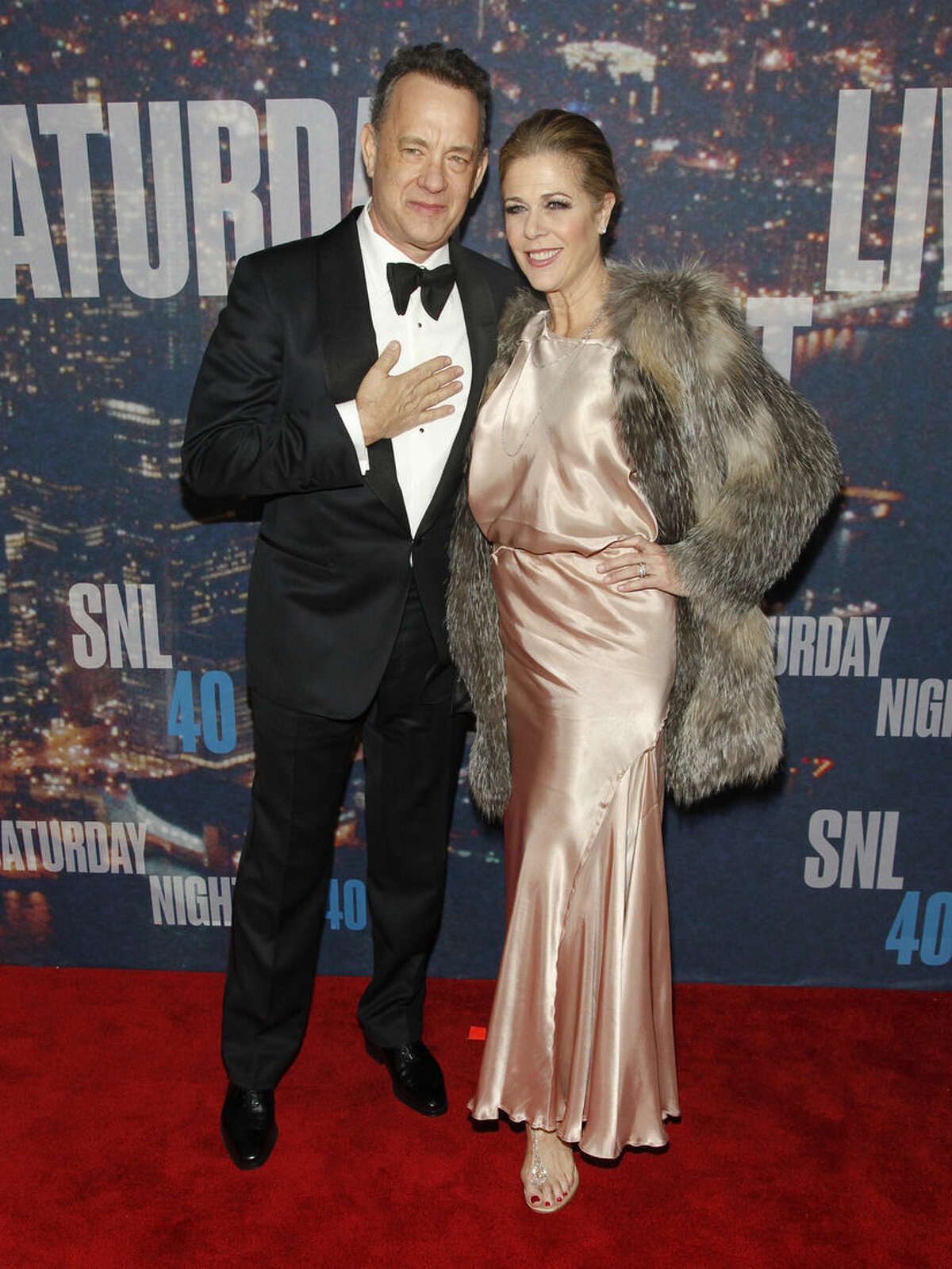 Tom Hanks, left, and Rita Wilson, right, attend the SNL 40th Anniversary Special at Rockefeller Plaza on Sunday, Feb. 15, 2015, in New York. (Photo by Andy Kropa/Invision/AP)