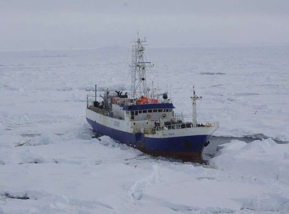 In this image provided by the U.S. Coast Guard the Austrailian fishing vessel the Antarctic Chieftain is seen from the the Coast Guard Cutter Polar Star as the cutter begins breaking up the ice around the vessel Friday Feb. 13, 2015. Rescuers on Saturday reached a fishing boat with 26 people aboard trapped in ice near Antarctica and plan to use an unmanned underwater vehicle to assess the damage to it. The U.S. Coast Guard icebreaker Polar Star traveled several hundred nautical miles through heavy ice to reach the Antarctic Chieftan. (AP Photo/U.S. Coast Guard, Lt. j.g. Gina Caylor)